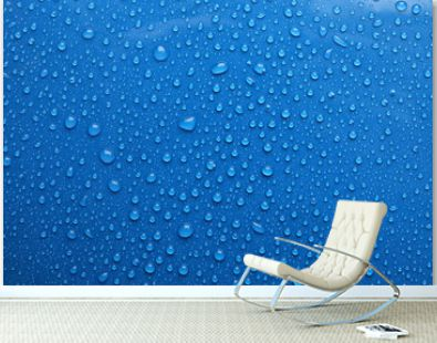 Water drops on blue background, top view