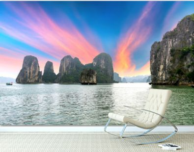 Beautiful Tourist cruise ship floating among limestone rocks at Ha Long Bay. This is the UNESCO World Heritage Site, it is a beautiful natural wonder in northern Vietnam