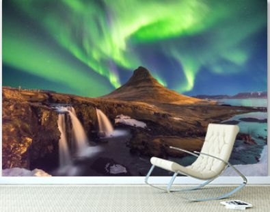A wonderful night with Kp 5 . Northern lights mountain Kirkjufell in Iceland.