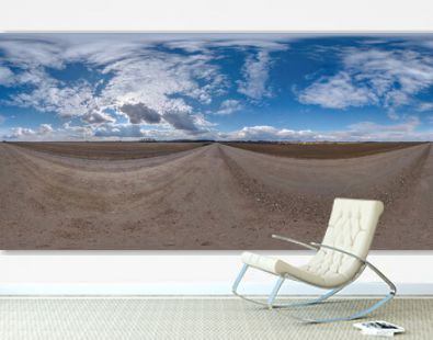 Full spherical seamless hdri panorama 360 degrees angle view on no traffic white sand gravel road among fields with cloudy sky in equirectangular projection, VR AR content