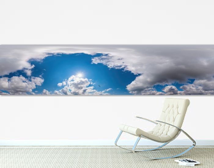 Blue evening sky seamless panorama spherical equirectangular 360 degree view with Cumulus clouds, setting sun. Full zenith for use in 3D graphics, game and aerial drone panoramas as sky replacement.
