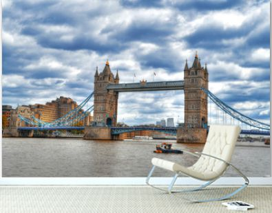 Beautiful and colorful high dynamic range - HDR image of the famous Tower Bridge of London on dramatic blue cloudy sky