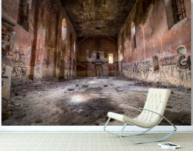 Abandoned interior of a church standing in the middle of the forest, completely empty.