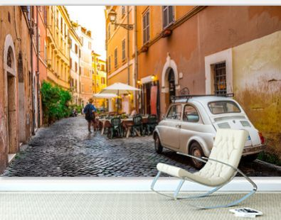 Cozy street in Trastevere, Rome, Europe. Trastevere is a romantic district of Rome, along the Tiber in Rome. Turistic attraction of Rome.