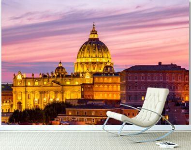 Cityscape view of Rome at sunset with St Peter Cathedral in Vatican.