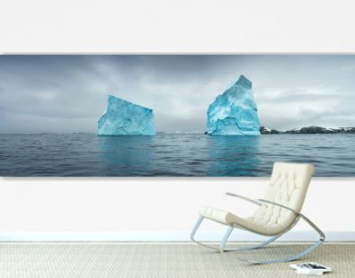 panorama with huge icebergs in strait in Antarctica