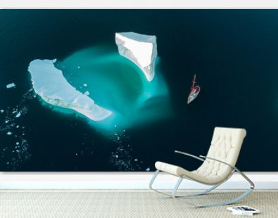 Iceberg and yacht. View from air. Drones view.