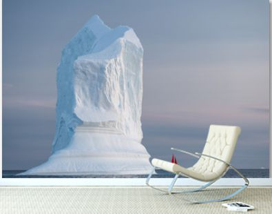 Red sail and large iceberg landscape during mid night sun