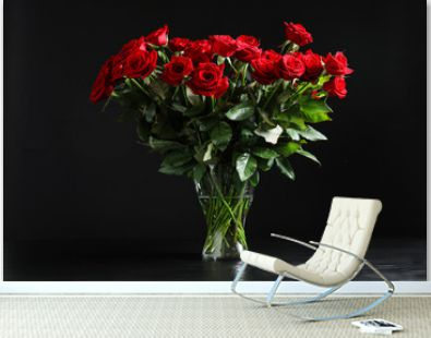 Vase with beautiful red rose flowers on black background