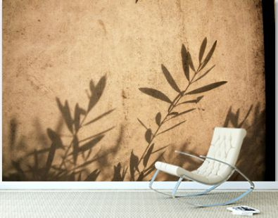 olive tree leaves shadows on the brown background
