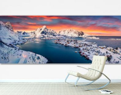 Panoramic evening view from flying drone of popular tourist destination - Reine town. Amazing sunset on Lofoten Islands, Norway,. Colorful winter seascape of Norwegian sea. Life over polar circle..