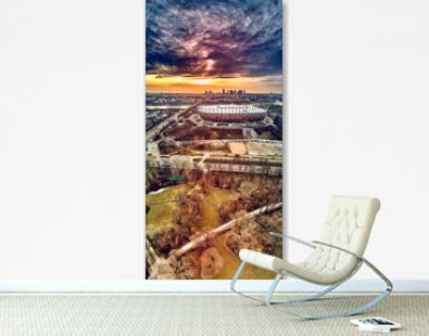 Beautiful panoramic aerial drone view to panorama of Warsaw modern City with skyscraper and The PGE Narodowy National Stadium (Polish: Stadion Narodowy) against the background of a dramatic sunset