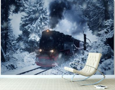 Historical steam locomotive struggles in the dark, through snow and storm to the mountain
