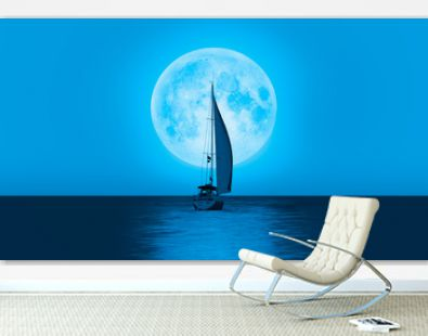 Lone yacht with super blue full moon