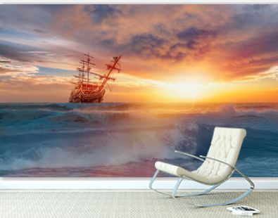 Old Sailing-ship in storm sea, dramatic sunset in the background
