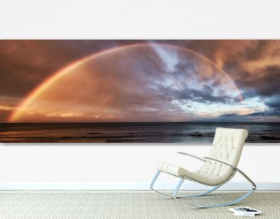 Panoramic view of rainbow over the ocean