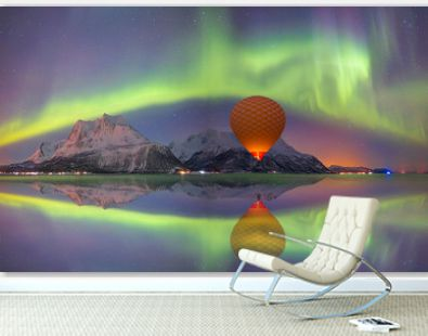 Hot air balloon flying with spectacular Northern lights - Northern lights (Aurora borealis) in the sky over Tromso, Norway