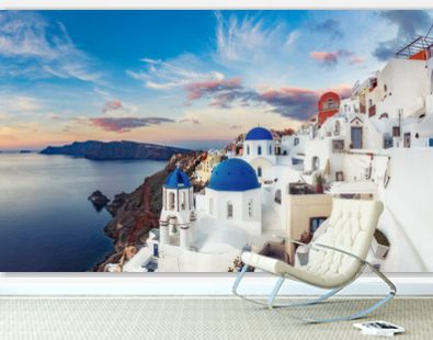 Beautiful view of Oia village on Santorini island in Greece at sunrise with dramatic sky.