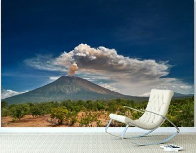 29 June 2018, Bali, Indonesia.Mount Agung volcano dramatic eruption over dark blue sky . Massive clouds of ash higlighted by magma.