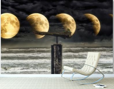 Wavy sea under a cloudy sky and lunar eclipse phases in the night - perfect for backgrounds
