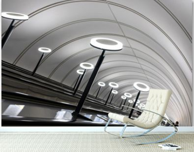 descending into the subway with escalators and round light lamps in Moscow metro
