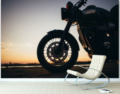 A motorcycle on the road with sunset light background