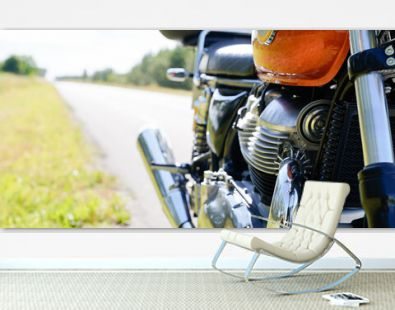 Vintage motorcycle exhaust pipes engine chrome aside road in concept roadtrip