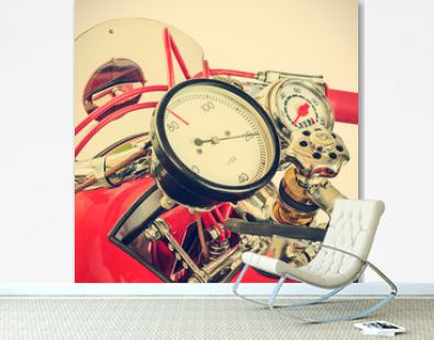 Retro styled image of the speedometer of a restored red racing motorcycle