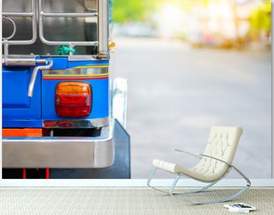 Background of colorful blue yellow tuk tuk traditional local taxi car for tourist with copy space. City lockdown coronavirus quarantine social distancing tourism empty in bangkok no traveler passenger