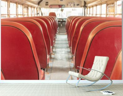 Looking forward in a school bus with red letherette seats landscape