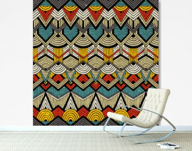 Colorful vector pattern in tribal style. Seamless hand-drawn background with grunge texture. EPS10.