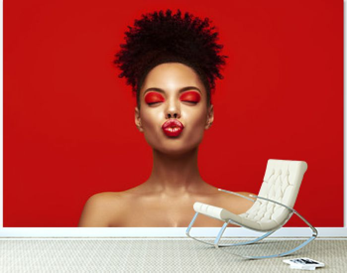 Kiss lips. Share love.Valentine Day. African makeup face. Satisfied Brunette young woman with afro hair style against colorful background.