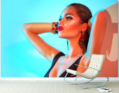 High Fashion model woman in colorful bright lights posing in swimsuit, portrait of beautiful sexy girl in swimwear, trendy accessories and make-up. Art design colorful make up. Summer fashion. Makeup