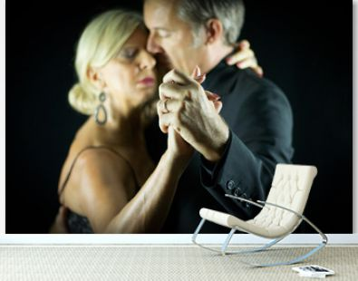 selective focus on two hands crossed of two adult tango dancers
