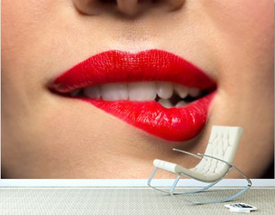 beauty, make up and mouth expression concept - close up of woman face with red lipstick biting lower lip