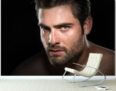 Intense determined motivational stare of conviction in eyes from masculine male athlete