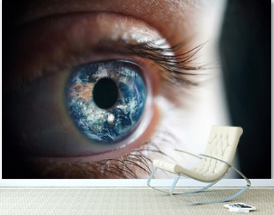 Macro photo of the woman's eye and Earth planet