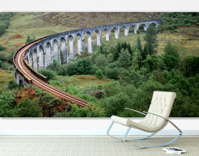 Glenfinnan Viaduct. Railway over the famous bridge. Famous Glenfinnan viaduct from film Harry Potter in Scotland, United Kingdom.