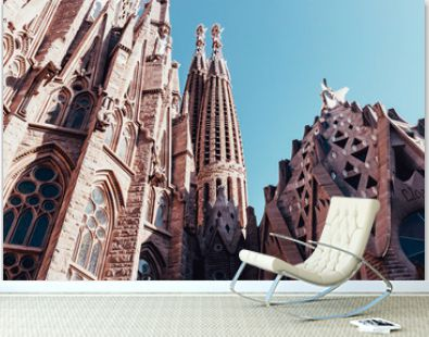 Sagrada Familia building exterior on hot summer day in Barcelona Spain with blue sky