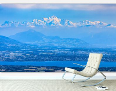 Image of snow-capped Mont Blanc Massif and Leman Lake seen from Jura Mountains in France.
