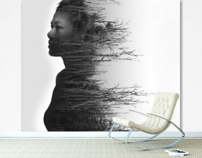 Double exposure portrait of young woman and dried forest