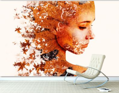 Double exposure portrait of young woman and autumn falling leaves.