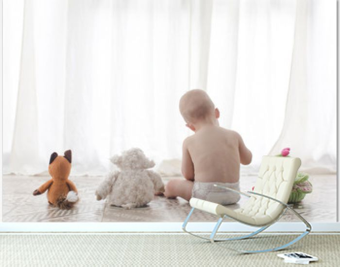 Infant child with plush toys