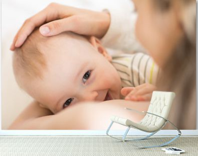 Picture of baby feeds mom's breast