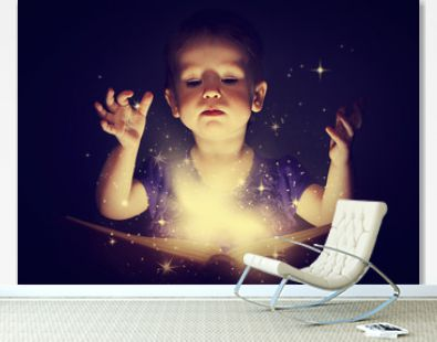 baby girl with magic book