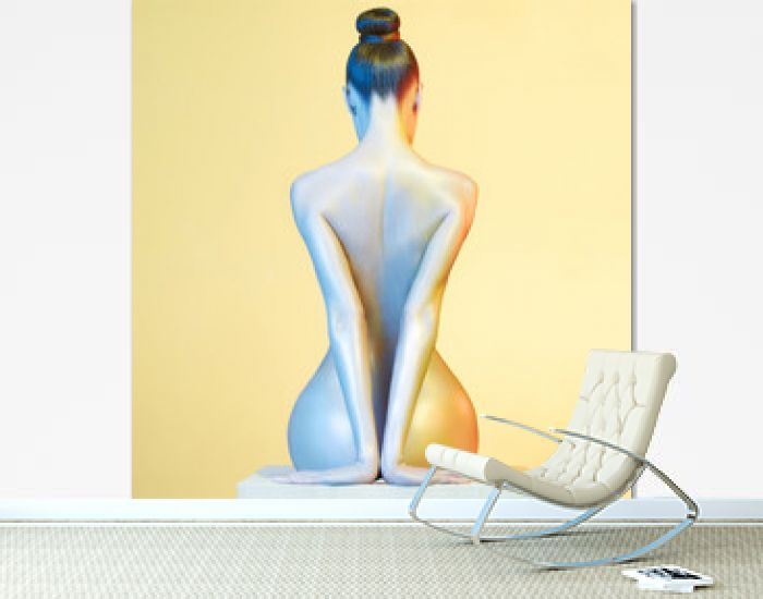 Elegant nude model in the light colored spotlights