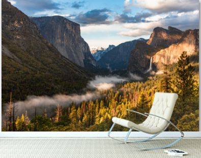 Sunset at Yosemite National park, Foggy river and waterfall in the sun lights. California, USA