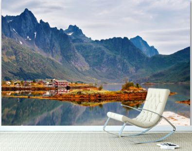 Norway island in fjord. Cloudy Nordic day. Hotel on island
