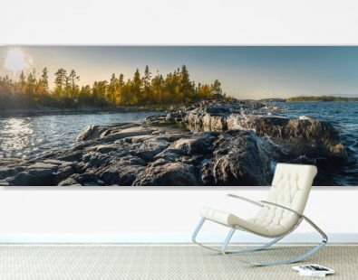 Beautiful panorama of a rocky shore. Nordic sunrise or sunset. Scenic view