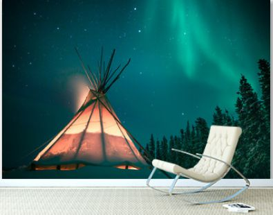 Glowing tipi / teepee in the snowy forest under the northern lights, Yellowknife, Northwest Territories, Canada